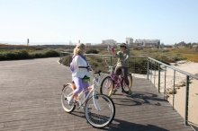 2 cyclists taking photos on Bayshore Bikeway